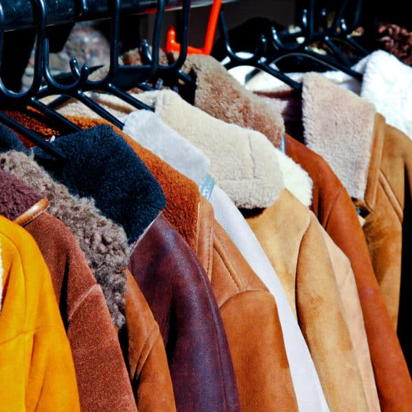 coats hanging in closet