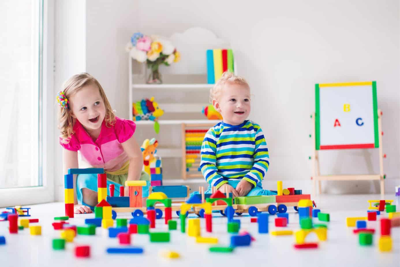 boy and girl playing with legos
