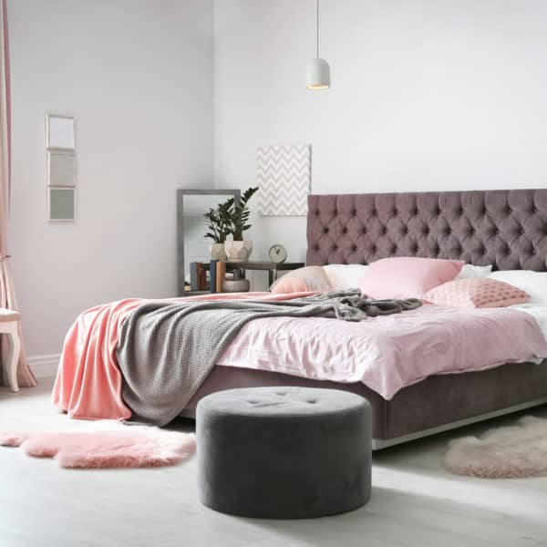 bedroom with pink coral and pink bedcovers and rugs