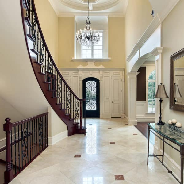 Foyer in luxury home with second floor window