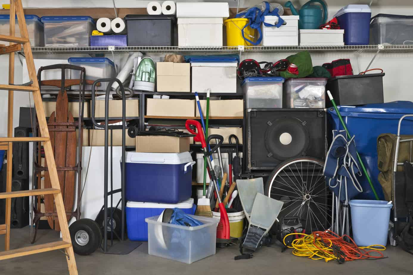 Overloaded suburban garage. Boxes, coolers, sporting gear and more.