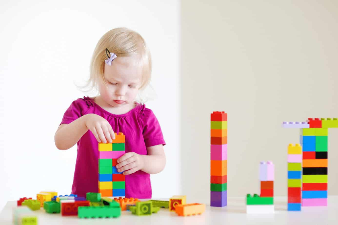 oddler girl building with legos