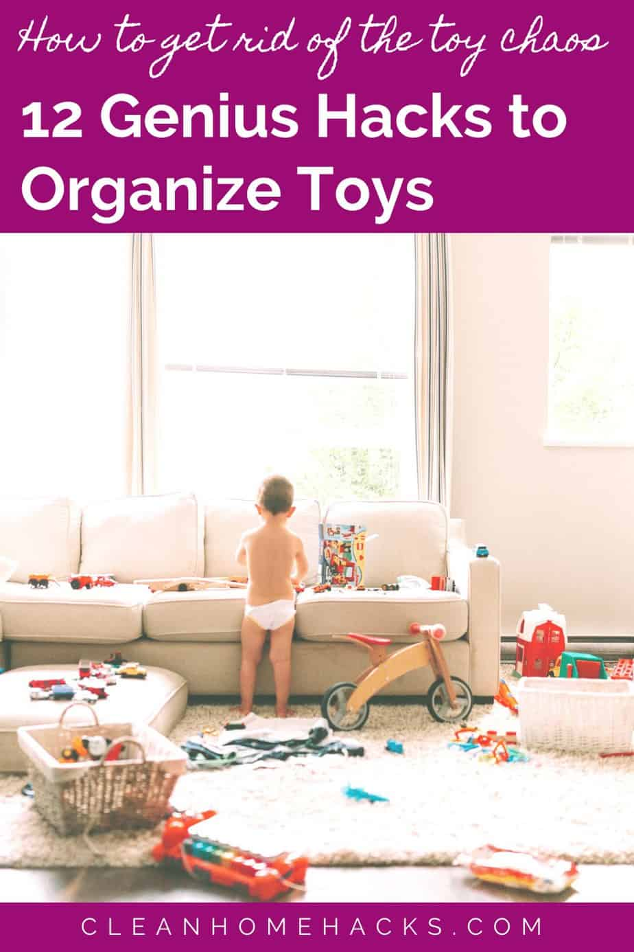 toddler in diapers standing in room with toys strewn all over