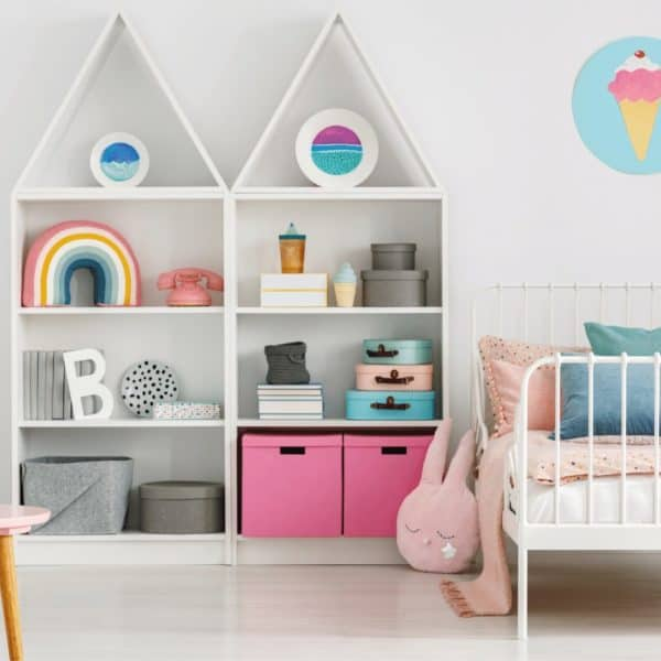 child's bedroom with organized shelf and storage bins