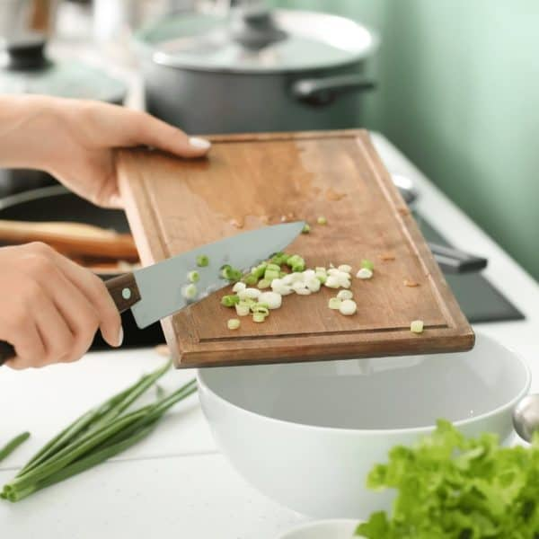 chopping onions on cutting board