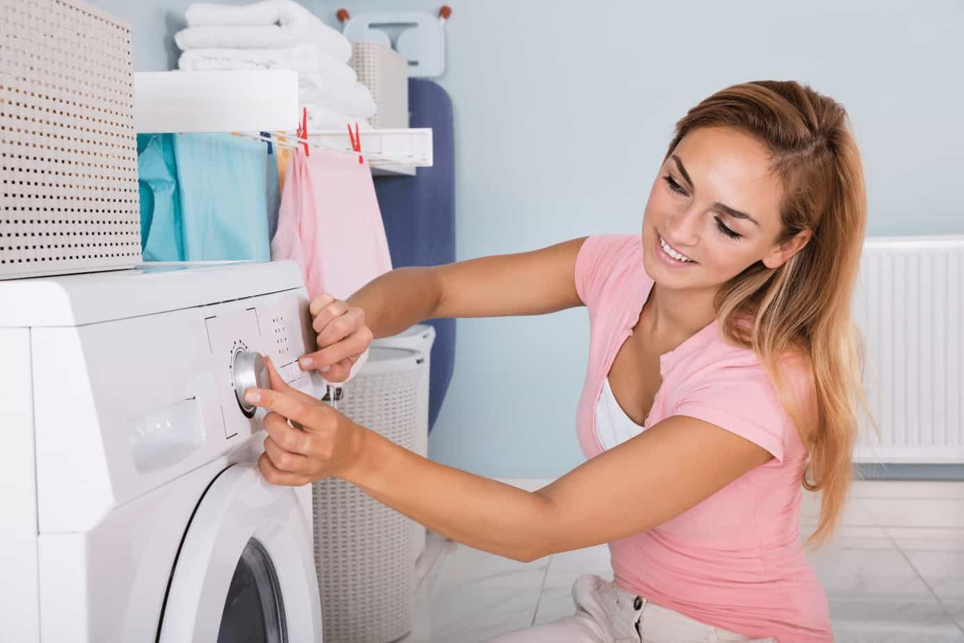 lady doing laundry turn on washer