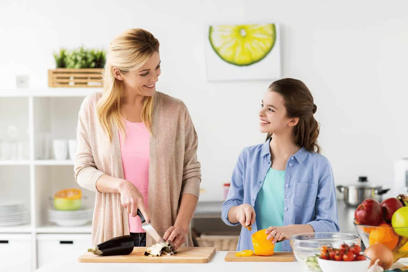mother and daughter cooking together in the kitchen