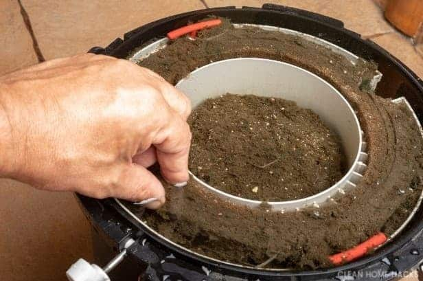 cleaning a dirty aquarium filter with man's hand for cleaning fish tank with vinegar