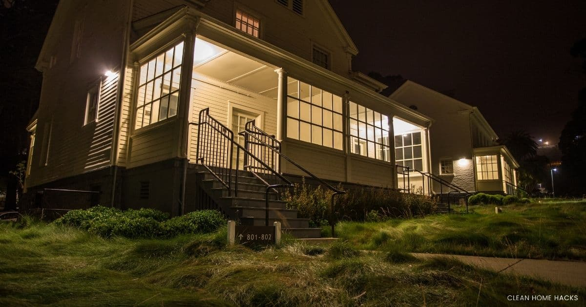 house with porch light on at night